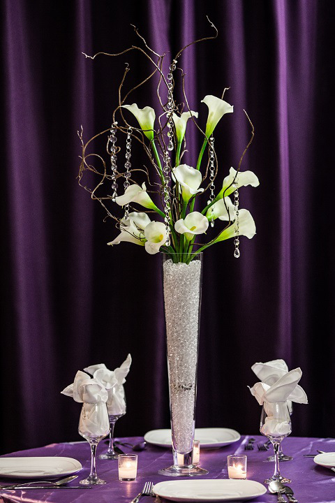 Calla lily with branches centerpiece rental weddings